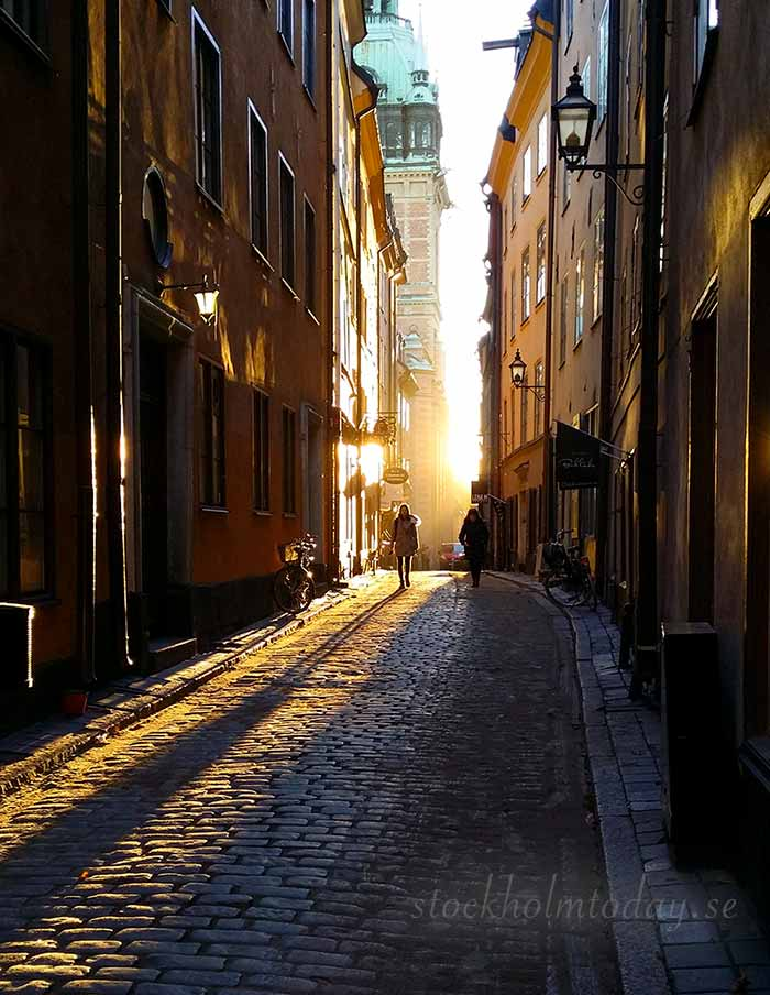old town stockholm sunset winter shadows